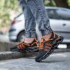 کفش ورزشی مشکی نارنجی مردانه مدل Arisan2