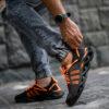 کفش ورزشی مشکی نارنجی مردانه مدل Arisan5