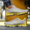 کفش ورزشی Adidas مردانه طوسی زرد مدل Gilva5