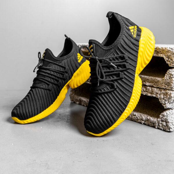 کفش ورزشی Adidas مردانه مشکی زرد مدلMahan 8